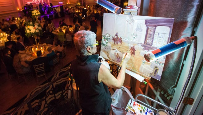 Joan Zylkin paints a scene from Julie and Ryan Dugan's wedding at the Cescaphe Ballroom in Philadelphia on Friday, July 11, 2014.