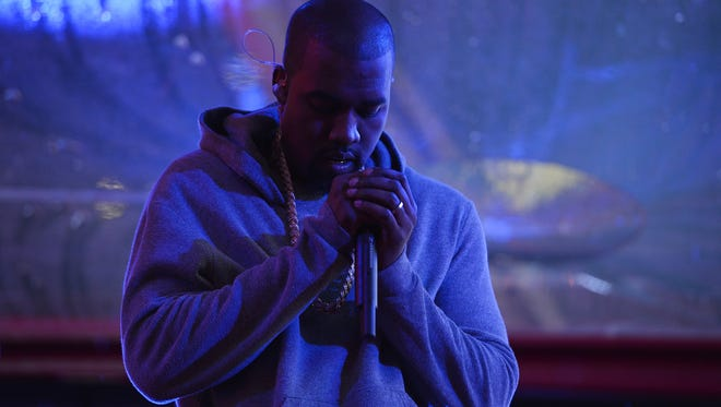 Kanye performs on World AIDS Day on Dec. 1, 2014 in New York City.