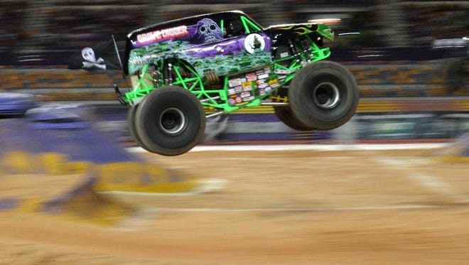 The Grave Digger energizes the crowd at Monster Jam at Queensland Sport and Athletics Centre on September 27, 2014 in Brisbane, Australia.