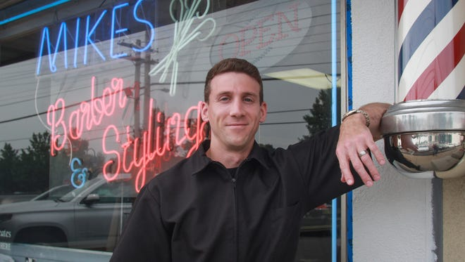 Mike Nesci left a career in medical sales to return to the family business, Mike's Barber & Stylist Shop in Middletown.