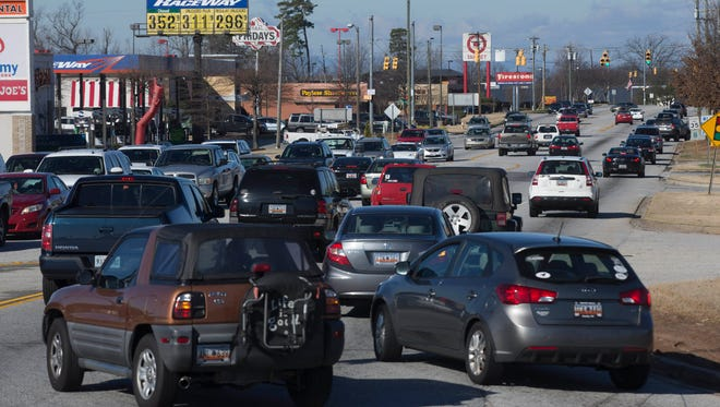 Traffic-snarled Woodruff Road is getting tamed in time for the holidays.