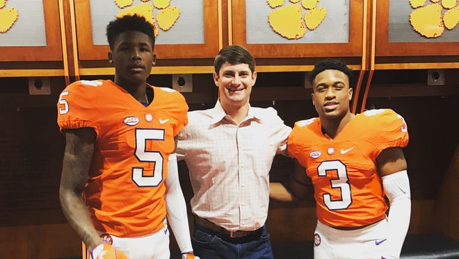 Oak Ridge wide receiver Tee Higgins, left, poses with Clemson assistant Jeff Scott, center, and Catholic wide receiver Amari Rodgers.