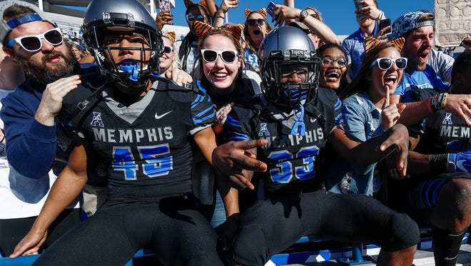 Memphis fans celebrates with the players after the Tigers defeated ECU 70-13 at the Liberty Bowl Memorial Stadium in Memphis, Tenn., Saturday, November 25, 2017.