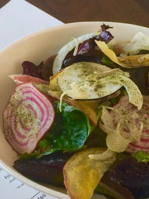 The colorful Esker Grove salad is served with herbs, seaweed and vegetables.