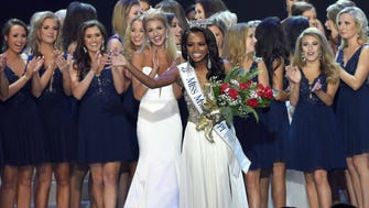 Miss Mississippi 2018 Asya Branchof Booneville waves to the crowd on Saturday, June 23, 2018, the final night of the Miss Mississippi Pageant at the Vicksburg Convention Center in Vicksburg, Miss.