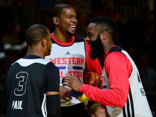 The 2013-14 All-NBA teams were announced June 4, and these three Western Conference All-Stars had reason to smile. Flip through this gallery to see who got votes.