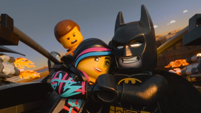 From left, Emmet, voiced by Chris Pratt, Wyldstyle, voiced by Elizabeth Banks, and Batman, voiced by Will Arnett, in 'The Lego Movie.'