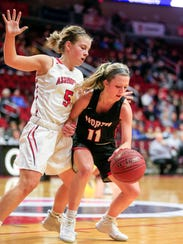 Katie Scott of North Polk drives to the basket during