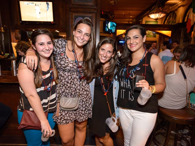 From left, Maia Ashman, Deborah Levy, Carly Metzger, and Nadessa Corea, all of Rochester. Rochester Fall Bar Crawl 2013 along East Avenue on September 20th.