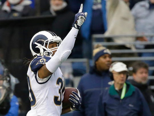 Los Angeles Rams running back Todd Gurley points skyward