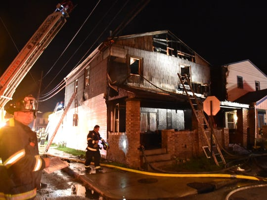 An Indianapolis firefighter was seriously injured when he fell through a roof as crews battled a house fire  in the 1400 block of Charles Street on the south side.