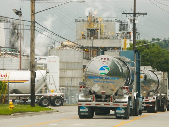 Trucks wait along Este Avenue for the all-clear on the day of leak at the Emery facility there.