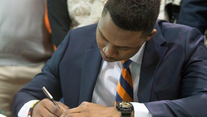 Prince Tega signs with Auburn University on Wednesday, Feb. 4, 2015, at Edgewood Academy outside Montgomery, Ala.