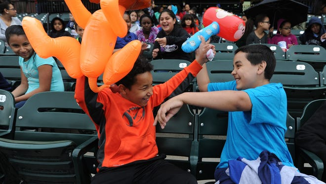Darian Lane, left, and Raymond Perez-Cruz goof around with blow up toys they bought during the Baseball in Education Day hosted by the York Revolution at Santander Stadium in 2015.