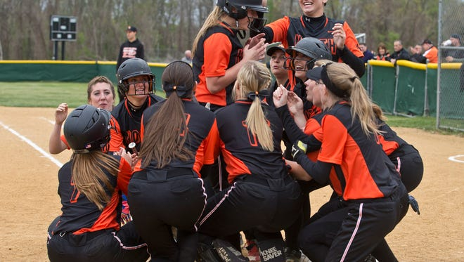 Middletown North's Christine Gebhardt is congratulated after hitting a home run in the first inning. Middletown North vs Middletown South softball.