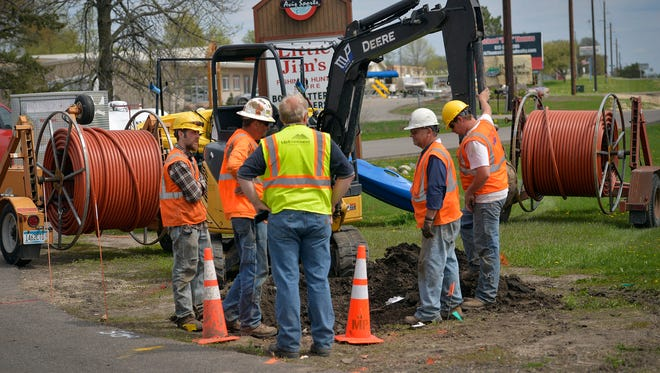A crew from MP Nexlevel working for Midcontinent Communications installs communications cable Tuesday, May 3, at a site along Minnesota Highway 55 in Annandale. Midcontinent is bringing television, phone, and faster high-speed Internet to the town.