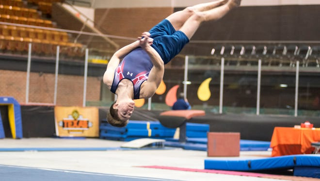 Martin Tovar competes with the All American Flame Gymnastix squad at the Wildfire Challenge Feb. 23 at McMorran Arena.