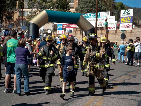 "Members of the Fry Fire District near Sierra Vista took part in a recent Bisbee 1000: The Great Stair Climb. This year, a ""Fire and Ice"" competition has been added in which firefighters in full gear like these will run 155 of the stairs while carrying a block of ice."