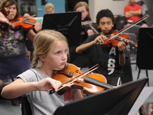 Elle Hiatt, 8, plays the violin in the Tulare County Junior Strings in 2014 at La Joya Middle School. The group is sponsored by the Tulare County Symphony League.