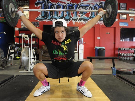 Dylan Contreras, 15, of Visalia lifts weights at Horizon Strength and Conditioning in preparation for national weight-lifting championships June 24-28 in Minnesota.
