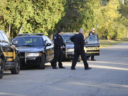 Authorities arrested a man who was squatting in a home near Northville Downs, prompting a police situation Tuesday morning.
