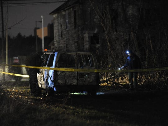 A body was discovered early Friday morning in a burned-out van on the city's east side.