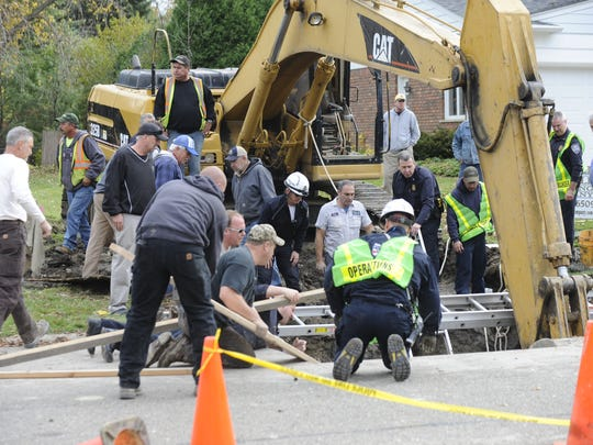 The worker was putting in a sewer line when the structure gave way Wednesday afternoon.