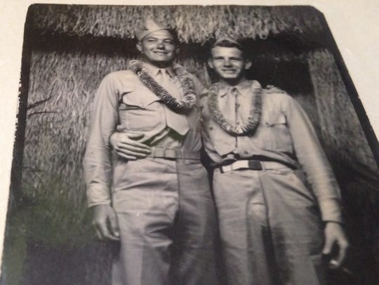 Hugh Mobley, left, was one of the first Marines to