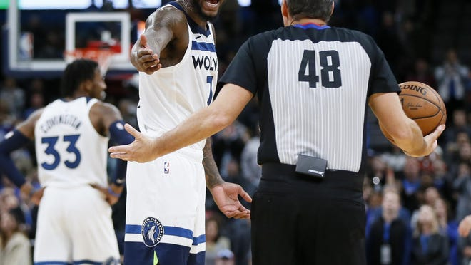 Minnesota's Jordan Bell talks to official Scott Foster after Bell's untucked jersey caused a delay of game with 1.1 seconds left in the fourth quarter of a game against Oklahoma City in December.
