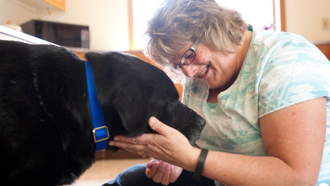 Cindy Larsen sits with Rodeo on Monday, May 16, 2016 at her home in Grand Ledge. Larsen set up a Facebook page to help find Rodeo after seeing his photo posted on other Facebook lost pets pages. Rodeo roamed parts of Eaton County for months after escaping from a shelter in Kalamazoo. Larsen said something about Rodeo captured her heart and she just had to find him.
