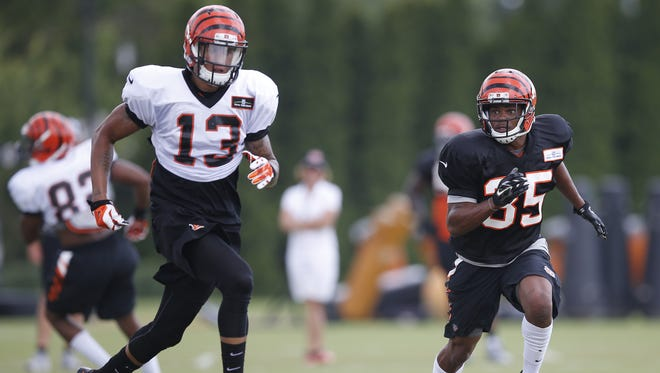 Bengals wide receiver Rashaun Simonise (left) is defended by Corey Tindal during training camp on Thursday.
