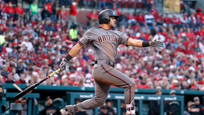Arizona Diamondbacks' David Peralta follows through on an RBI-single during the second inning of a baseball game against the St. Louis Cardinals, Thursday, April 5, 2018, in St. Louis. (AP Photo/Jeff Roberson)