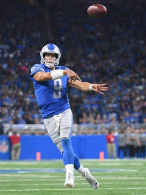 Detroit Lions quarterback Matthew Stafford throws a touchdown pass to tight end Darren Fells during the fourth quarter against the Carolina Panthers at Ford Field.
