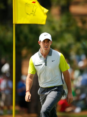 Rory McIlroy walks to the 7th green during the final round of the 2014 Masters at Augusta.