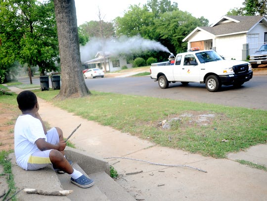 FILE PHOTO - Javarrion Chism, 6, watches the mosquito