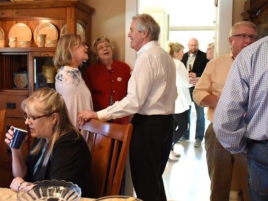 John Paulson talks with Cystal Van Wyhe and Shirley