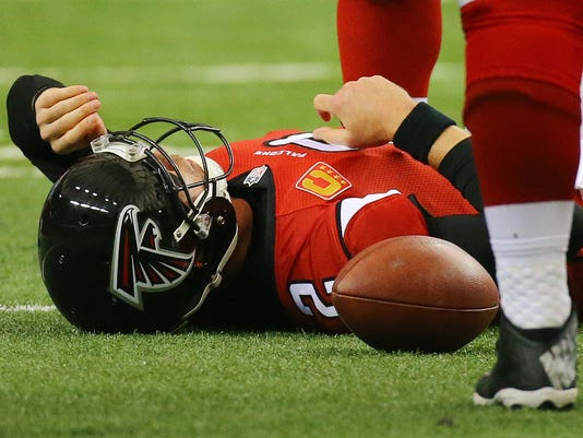 Atlanta Falcons quarterback Matt Ryan lies on the ground after being leveled by Pittsburgh Steelers linebacker Jason Worilds during an NFL football game Sunday, Dec. 14, 2014, in Atlanta. (AP Photo/Atlanta Journal-Constitution, Curtis Compton)  MARIETTA DAILY OUT; GWINNETT DAILY POST OUT; LOCAL TELEVISION OUT; WXIA-TV OUT; WGCL-TV OUT