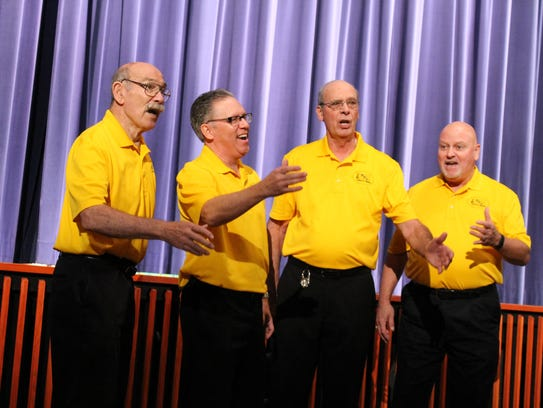 Members of the HHT Plymouth Barbershop Society perform