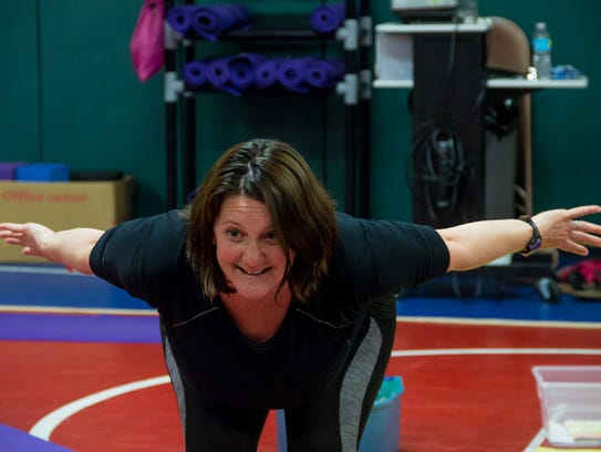 Cari Terry leads students through a series of yoga