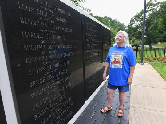 """Mary Louise Worthy at the Vietnam Memorial in Cleveland park Thursday, May 24, 2018. The memorial was designed by her late husband Floyde Edward """"Eddy"""" Worthy."""