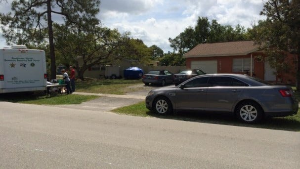 Law enforcement is on scene at a home on Poinciana Street in Naples.