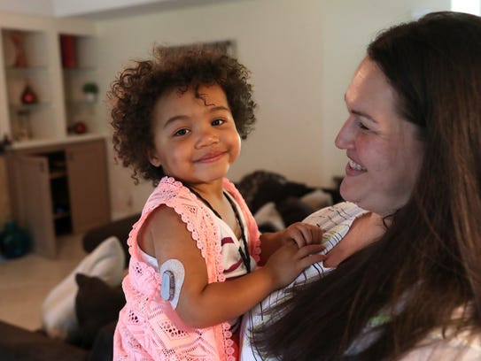 Rebeka Joseph with her daughter Leah, 2, who uses a