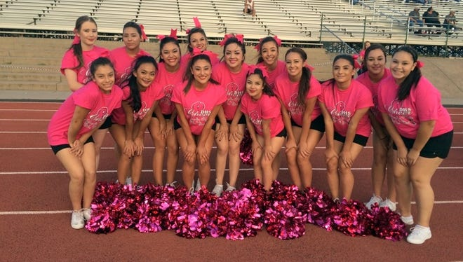 """The Deming High Cheerleaders encourage fans to wear pink for Friday's Wildcat's home football game against the Las Cruces High Bulldawgs in recognition of Breast Cancer Awareness Month. Kick off is at 7 p.m., at DHS Memorial Stadium and the cheer squad is anticipating a """"Pink Out."""""""