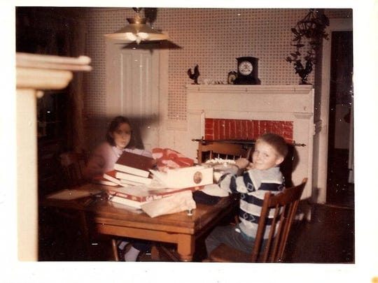 On left is Susan Parker and on right is her brother, Russ Hargreaves, in the dining room at 309 Newton St. in the mid 1960s.