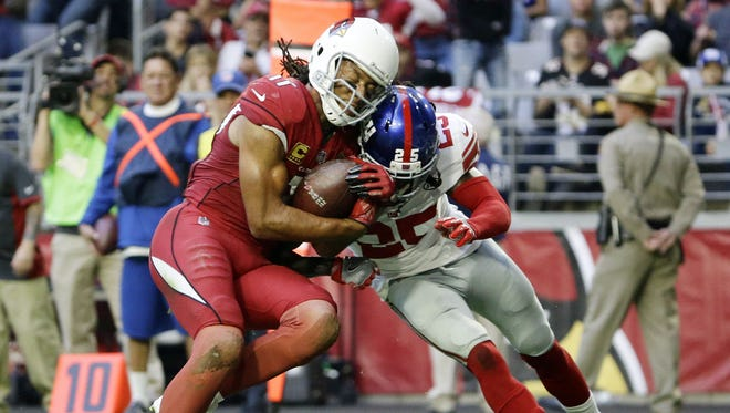 Arizona Cardinals Larry Fitzgerald scores a touchdown and makes his 100th reception of the season against the New York Giants in the first half on Dec. 24, 2017 at University of Phoenix Stadium in Glendale, Ariz.