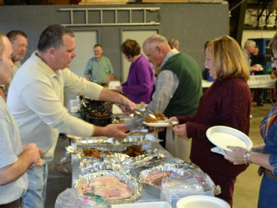 Guests  are served by fireman at Sunday's annual  gathering at the Morganfield  fire Department.