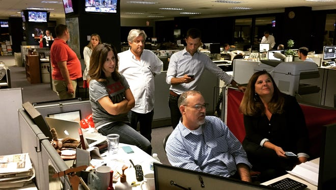 Arizona Republic and azcentral editors wait for a winner to be called in Tuesday night's election.