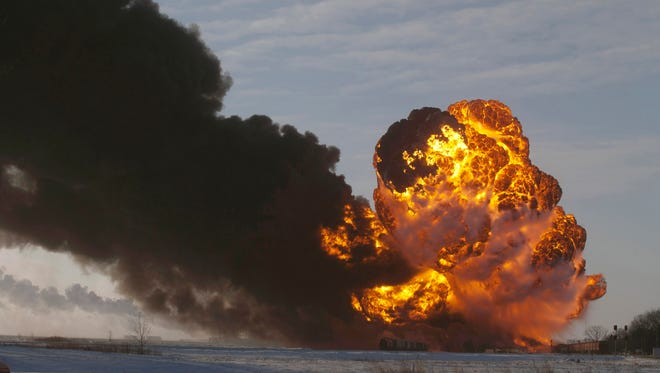 A fireball goes up at the site of an oil train derailment near Casselton, N.D., on Dec. 30, 2013. A fire engulfed tank cars loaded with oil on a Burlington Northern Santa Fe train after a collision about a mile from Casselton.