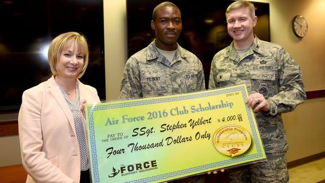U.S. Air Force Col. Terry Hamrick, 17th Training Wing Vice Commander, and Toni Hansen, 17th Force Support Squadron Director, award Staff Sgt. Stephen Yelbert, , 17th Comptroller Squadron financial services technician and Non-Commissioned Officer in charge for reports and analysis, the Air Force 2016 Club Scholarship for 4,000 dollars at the Norma Brown Building on Goodfellow Air Force Base, Texas, June 28, 2016. Yelbert received 2nd place in the scholarship competition throughout the Air Force.