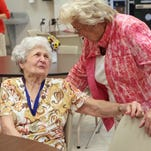 Catherine Bordelon, left, visits with Shirley Cagle, assistant director at the Ouachita Council on Aging before a reception honoring volunteers in 2013